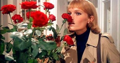 Mia Farrow with roses